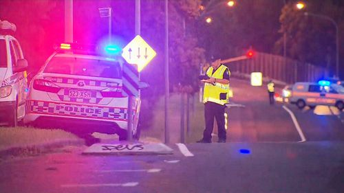 The police officer was injured when he was struck by a car speeding in Tarragindi, south of Brisbane. (9NEWS)