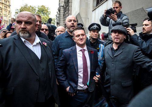 Far-right figurehead Tommy Robinson, real name Stephen Yaxley-Lennon arrives at the Old Bailey on October 23, 2018 in London, England.