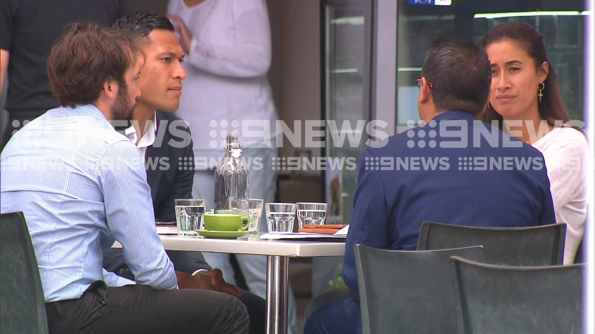 Israel Folau at a cafe with his wife maria and two associates.