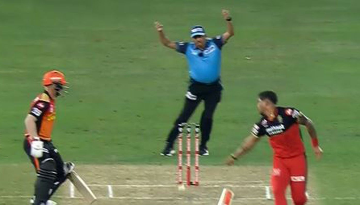 David Warner is run out after a deflection off Umesh Yadav at the IPL.