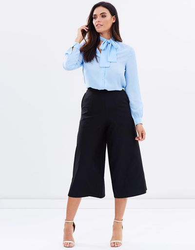 "<a href=""http://www.theiconic.com.au/penny-bow-blouse-459008.html?wt_se=au.sem_nonbrand.google.pla.adgroup.ad&amp;wt_se=sem_nonbrand.google.Brands.AU_Shopping_Generic_RLSA-_-sbra_au-shp_all_products%20-%20Generic_RLSA.&amp;kpid=AT049AA91DAE&amp;utm_source=Google&amp;utm_medium=sem_nonbrand&amp;utm_content=sbra_au-shp_all_products---Generic_RLSA&amp;utm_campaign=AU_Shopping_Generic_RLSA&amp;utm_term=&amp;gclid=CPeo3PL90tMCFYujvQodeRILqA"" target=""_blank"" draggable=""false"">Atmos &amp; Here Penny Bow Blouse, $59.95.</a><br /> Channel Mrs Beckham in a fresh ice blue blouse. The hue to wake up even the most tired mummy face. Plus, we love the on-trend neck tie."