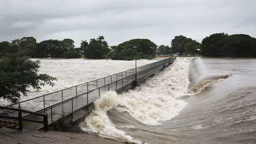 Floodwaters are seen at Aplins Weir in Townsville.