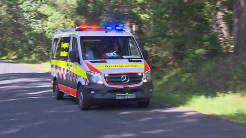 An ambulance rushes to the premises in Coledale, a small seaside village 18 kilometres north of Wollongong.