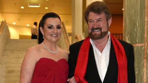 Jacqui Lambie and Derryn Hinch strike a pose in coordinated outfits at Canberra's Midwinter Ball