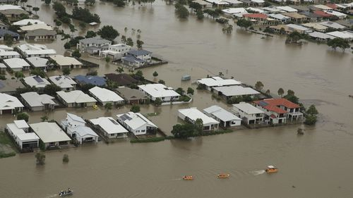 Andrew Rankin captured the flood devastation in Townsville from the air.