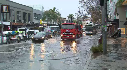 Neutral Bay traffic is slowed due to flooding through many streets.