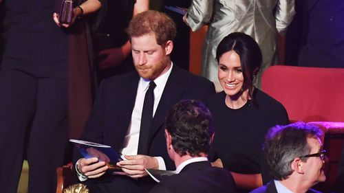 Prince Harry and Meghan Markle take their seats. (PA)