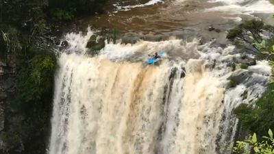 Kayaker risks life in terrifying waterfall plunge