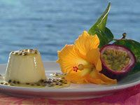 White choc panna cotta with passionfruit sauce