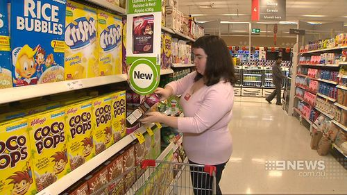 Part of Ms Dalliston's role is to 'face up' products in the store to make them appear neater on the shelf. (9NEWS)