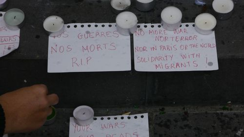 A note at the Place de la Republique reads: 'No more war, nor terror nor in Paris or the world, solidarity with migrants!'
