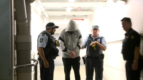 AFP officers escorted the man on a flight from Belgrade to Sydney, landing late last night.