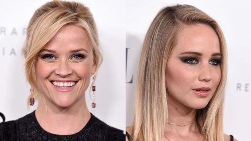 Reese Witherspoon and Jennifer Lawrence arrive at the 24th annual ELLE Women in Hollywood Awards. (AP)