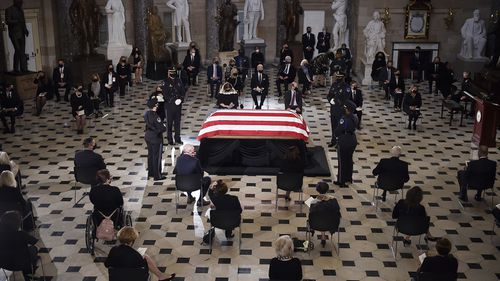 A US Capitol Police honour guard surrounds the flag-draped casket of Justice Ruth Bader Ginsburg as lies in state in Statuary Hall of the US Capitol, Friday, Sept. 25, 2020 in Washington.