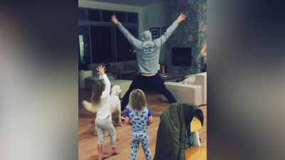 Cool dad Chris Hemsworth dances to 'Wrecking Ball' with his kids and dog