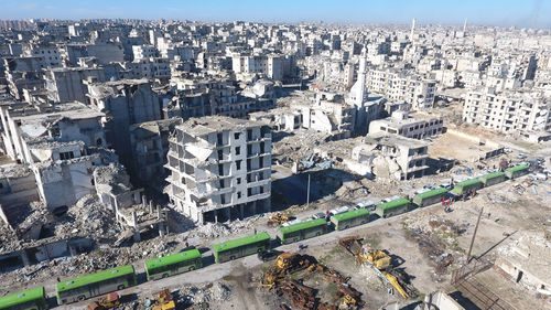 Aleppo residents leave the city in a convoy of buses. (AAP)