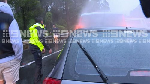 The crew came to the drivers' aid. (9NEWS)