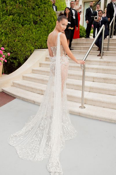 From behind the Ralph and Russo dress is equally revealing.