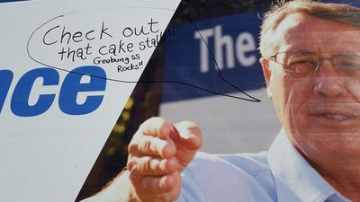Wayne Swan, happy for his posters to be defaced for a good cause. (Facebook/Wayne Swan)