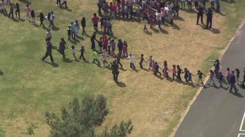 Students are evacuated after a shooting at a US elementary school. (Twitter)