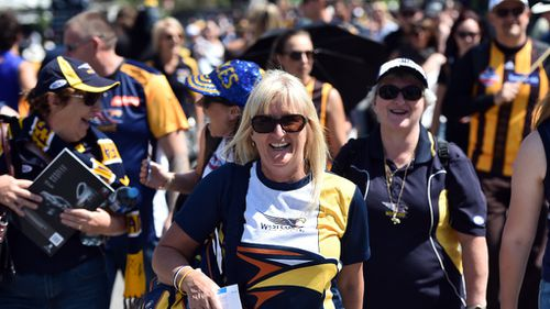 AFL Grand Final attendees should expect warm temperatures at the MCG. (AAP)