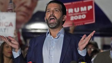 Donald Trump Jr., gestures during a news conference at Georgia Republican Party headquarters.
