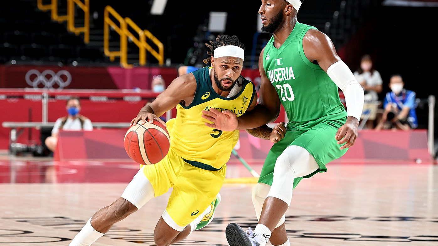 Patty Mills of Australia takes on the defence of Josh Okogie of Nigeria during the preliminary rounds of the Men's Basketball match between Australia and Nigeria on day two of the Tokyo 2020 Olympic Games at Saitama Super Arena on July 25, 2021 in Saitama, Japan. (Photo by Bradley Kanaris/Getty Images)
