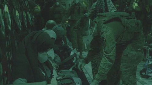 Evacuees on board the ADF aircraft on its way to the Middle East Base.
