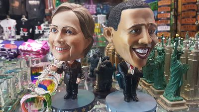 A Hillary bobblehead sits alongside one of her biggest fans, President Barack Obama in a New York souvenir shop. (9NEWS/Ehsan Knopf)
