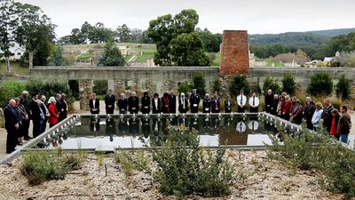 Family and friends of those killed in the Port Arthur massacre lay floating candles in the reflection pool at the memorial site during a memorial service to mark the 10th aniversary in 2006.