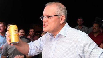 Scott Morrison brandishes his Queensland credentials with a can of XXXX.