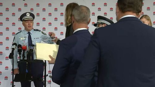 The Commissioner warned him 'don't come near me' before NSW Police removed the man.