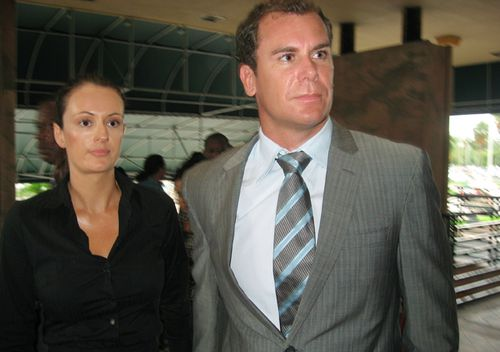 Former AFL star Wayne Carey (right) and his girlfriend Kate Neilson leave Miami-Dade County Court in Florida after pleading guilty to battery on a law enforcement officer, Oct. 14, 2008. Carey has been sentenced to community service, counselling and two years probation.