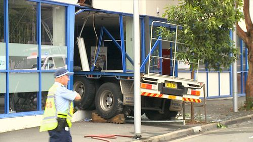 St Mary's shop owners and pedestrians watched dumbfounded while workers in the building dodged the runaway vehicle.