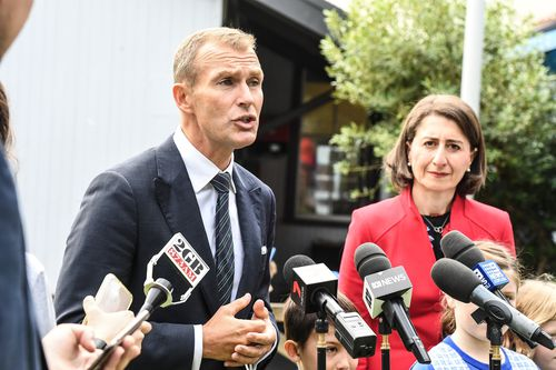 NSW Education Minister Rob Stokes has ordered a review into mobile phone usage in schools and their links to cyber-bullying and online safety. Picture: AAP.