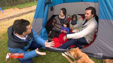Family pitches tent in nearby park to escape construction noise.