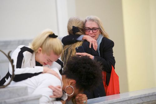 Accuser Lili Bernard, foreground, is consoled by grief counselor Caroline Heldman left, as accusser Victoria Valentino, right, is comforted outside the courtroom after Bill Cosby was found guilty in his sexual assault retrial.