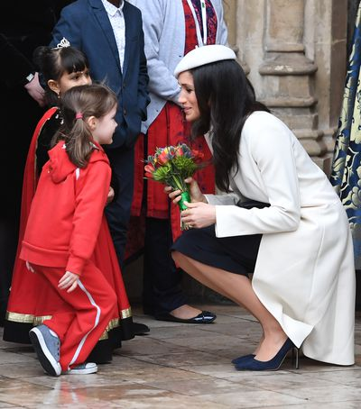 A girl curtsies for the Duchess at Westminster Abbey