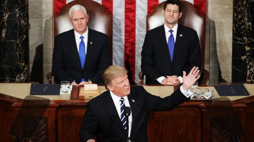 The president was flanked by Vice President Mike Pence and House Speaker Rep. Paul Ryan. (Getty Images)