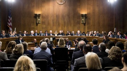 Christine Blasey Ford faces the Senate Judiciary Committee, Republicans on the left, Democrats on the right.