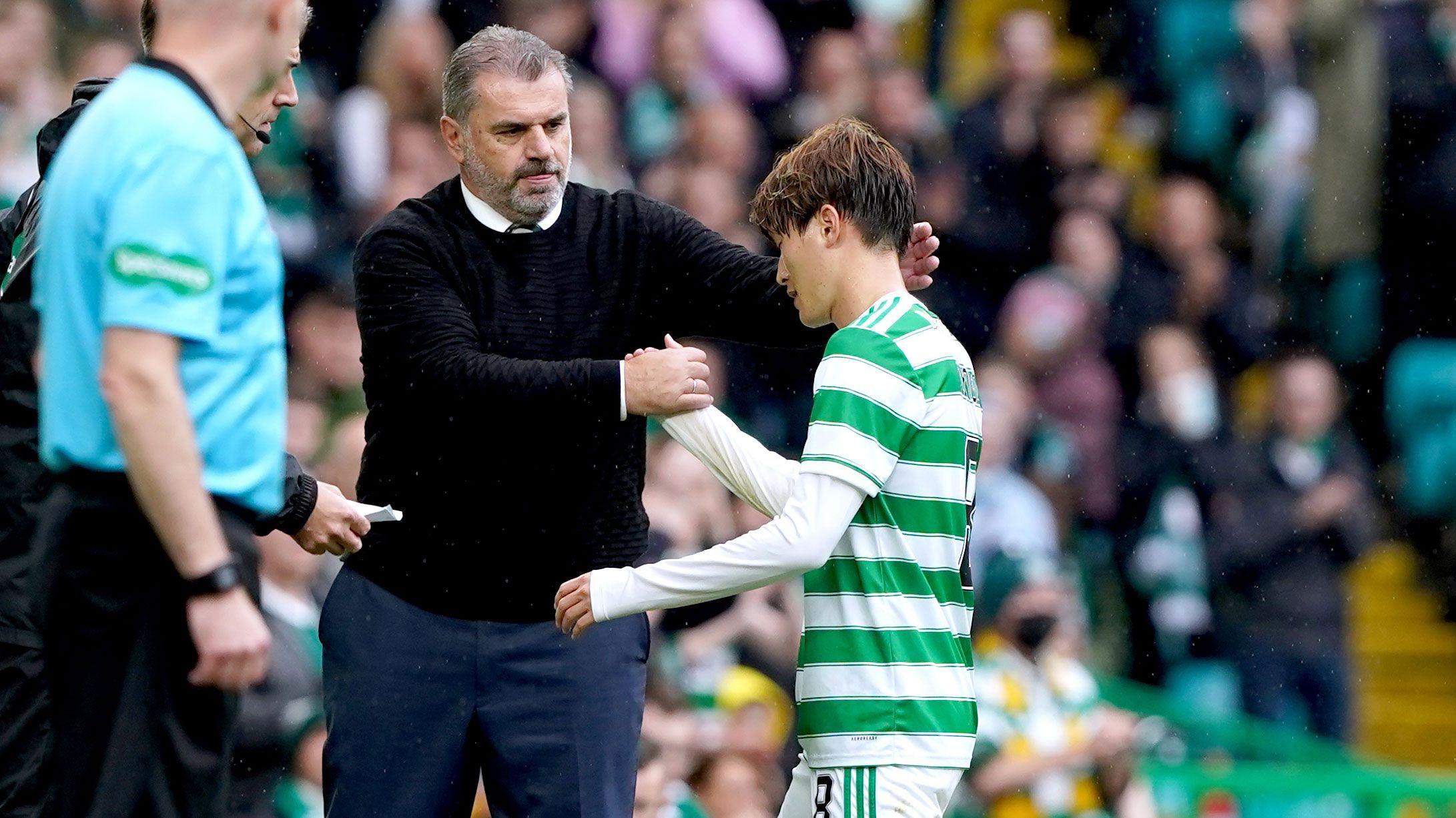 Celtic's Kyogo Furuhashi shakes hands with manager Ange Postecoglou.