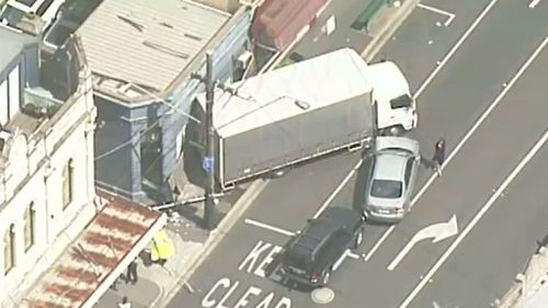 The six-tonne delivery vehicle did not make a stop until it crashed into a shopfront. (9NEWS)