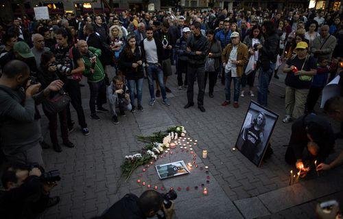 People attend a vigil as a protest against the rape murder of journalist Viktoria Marinova in Sofia, Bulgaria.