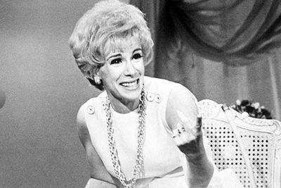 In 1969, Joan hosted her first short-lived syndicated talk show That Show with Joan Rivers... with Johnny Carson as her first guest.<br/><br/>She also had a comedy <I>Rabbit Test</I> in the works, putting her home up as collateral for the movie she directed. In 1978, she publicly lit loan papers on fire at a Beverly Hills bank after the movie grossed $10 million.  <br/><br/>Source: Getty