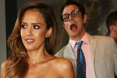 Johnny Knoxville sneaks up behind Jessica Alba.