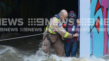A multi-agency crew execute a dramatic rescue, plucking a family from floodwater.