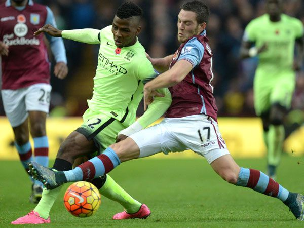 Manchester City's Nigerian striker Kelechi Iheanacho (L) is tackled by Aston Villa's French midfielder Jordan Veretout. (AFP)