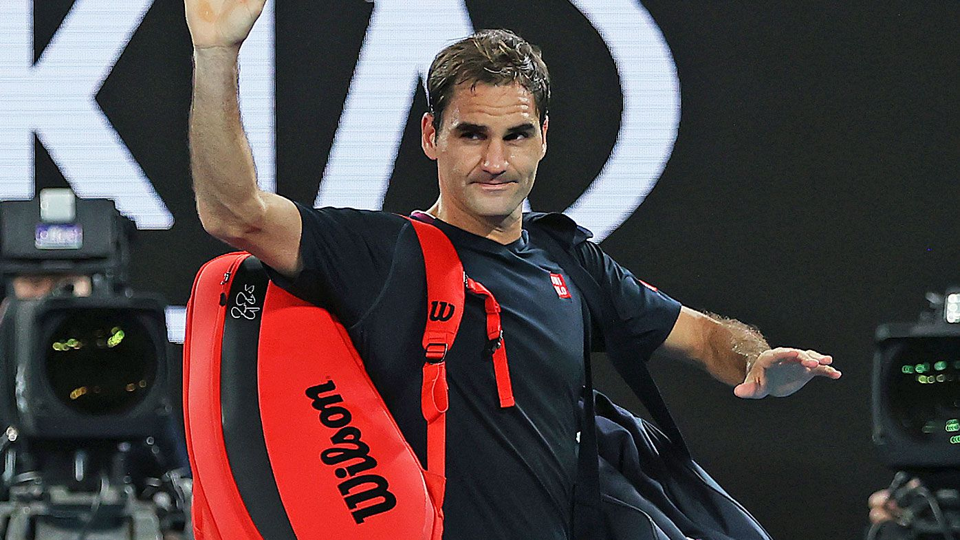 Roger Federer of Switzerland acknowledges the crowd as he walks off court after losing his Men's Singles Semifinal match against Novak Djokovic