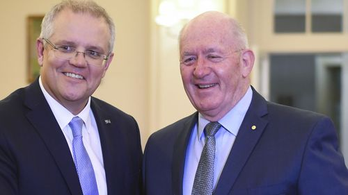 Australian Prime Minister Scott Morrison shakes hands with Australian Governor-General Sir Peter Cosgrove during a swearing-in ceremony at Government House in Canberra.
