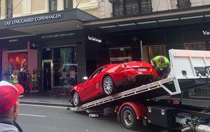 Man charged after Ferrari crashes into Sydney shopfront